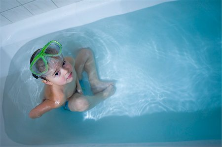 Boy in Bathtub Wearing Green Diving Mask Stock Photo - Rights-Managed, Code: 700-03777749