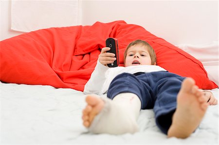 Boy with Cast on Leg Dialing Cell Phone Stock Photo - Rights-Managed, Code: 700-03777774
