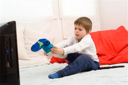 Boy with Cast on Leg Putting on Sock Stock Photo - Rights-Managed, Code: 700-03777770