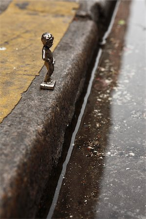 Miniature Figurine of Boy Peeing in Gutter Stock Photo - Rights-Managed, Code: 700-03777881