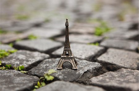 Miniature Eiffel Tower on Cobblestones Stock Photo - Rights-Managed, Code: 700-03777883