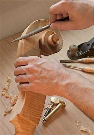 scroll (design) - Close-Up of Luthier's Hands Making Cello Stock Photo - Rights-Managed, Code: 700-03777920