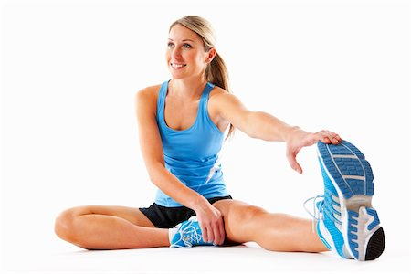 Woman Stretching in Studio Stock Photo - Rights-Managed, Code: 700-03777931