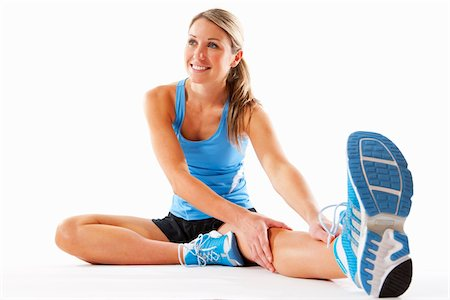 sole - Woman Stretching in Studio Stock Photo - Rights-Managed, Code: 700-03777932