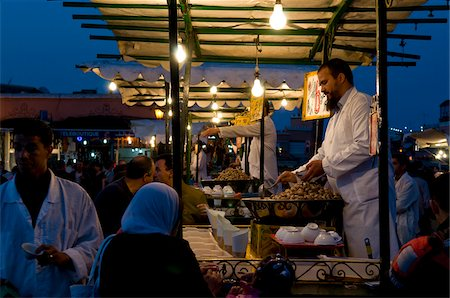 Food Vendor Cooking Snails, Djemaa El Fna, Marrakech, Morocco Stock Photo - Rights-Managed, Code: 700-03778101