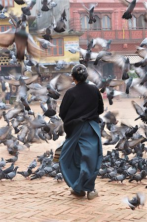 Woman Feeding Pigeons, Boudhanath, Bagmati, Kathmandu, Nepal Stock Photo - Rights-Managed, Code: 700-03778222