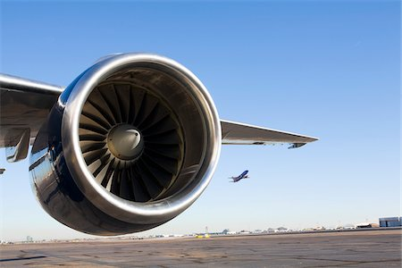 Close-Up of Airplane Engine on Runway Stock Photo - Rights-Managed, Code: 700-03778514