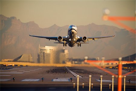Airplane Taking Off at Sunset Stock Photo - Rights-Managed, Code: 700-03778516