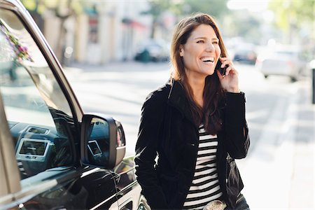 Woman Near Car Talking on Cell Phone Stock Photo - Rights-Managed, Code: 700-03778621
