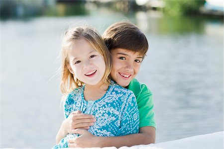 Brother and Sister Hugging Outdoors Stock Photo - Rights-Managed, Code: 700-03778632