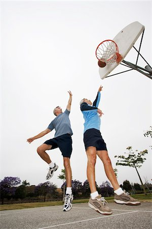 Two Men Playing Basketball Stock Photo - Rights-Managed, Code: 700-03784265