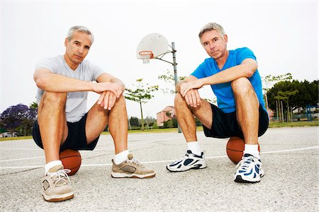 peter griffith - Two Men Sitting on Basketballs on Basketball Court Stock Photo - Rights-Managed, Code: 700-03784261
