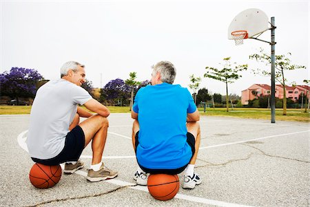 peter griffith - Two Men Sitting on Basketballs on Basketball Court Stock Photo - Rights-Managed, Code: 700-03784262