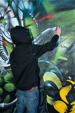 Boy Spray Painting Graffiti Stock Photo - Rights-Managed, Code: 700-03787574