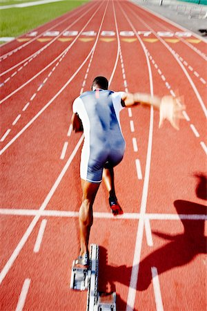 race track (people) - Runner Leaving Starting Block Stock Photo - Rights-Managed, Code: 700-03787631