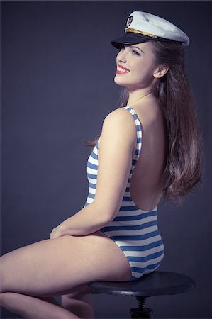 female rear end - Pin Up Girl Wearing Swimsuit and Captain's Hat Stock Photo - Rights-Managed, Code: 700-03814110