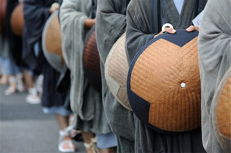 Close-Up of Monks Holding Hats While Standing in Line, Kyoto, Kansai, Honshu, Japan Stock Photo - Rights-Managed, Code: 700-03814291