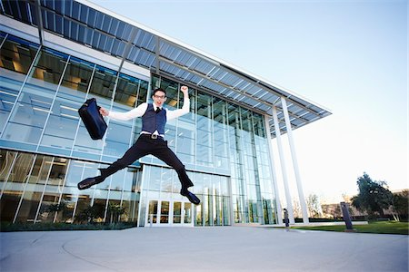 peter griffith - Businessman Leaping in front of Building Stock Photo - Rights-Managed, Code: 700-03814366