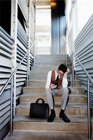 peter griffith - Frustrated Businessman Sitting on Stairs Stock Photo - Rights-Managed, Code: 700-03814375