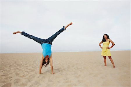 peter griffith - Young Woman Doing Cartwheel while Friend Watches Stock Photo - Rights-Managed, Code: 700-03814385