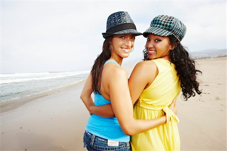 peter griffith - Two Friends on Beach with Arms Around Each Other Stock Photo - Rights-Managed, Code: 700-03814388