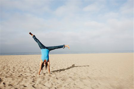 peter griffith - Woman Doing Cartwheel on Beach Stock Photo - Rights-Managed, Code: 700-03814382