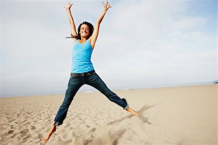 peter griffith - Woman Jumping on Beach Stock Photo - Rights-Managed, Code: 700-03814383