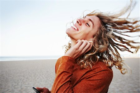peter griffith - Young Man Listening Music on Beach Stock Photo - Rights-Managed, Code: 700-03814401
