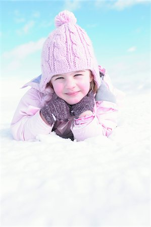 Portrait of Girl Lying in Snow Stock Photo - Rights-Managed, Code: 700-03814446