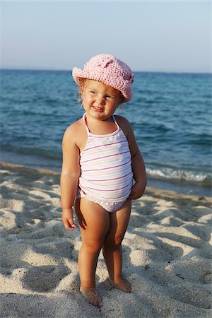 Little Girl Wearing Bathing Suit on Beach Stock Photo - Rights-Managed, Code: 700-03814456