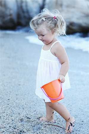 Little Girl with Bucket at Beach Stock Photo - Rights-Managed, Code: 700-03814465