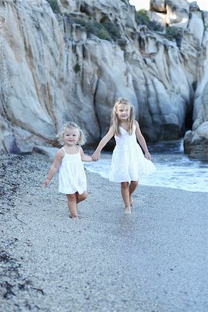 supervising - Sisters Holding Hands on Beach Stock Photo - Rights-Managed, Code: 700-03814463