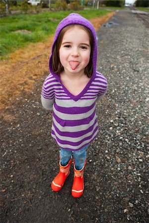 Girl Sticking Out Tongue Stock Photo - Rights-Managed, Code: 700-03815002