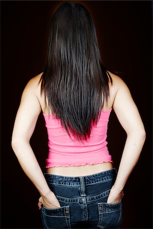 Rear View of Woman with Hands in Pockets Stock Photo - Rights-Managed, Code: 700-03836215
