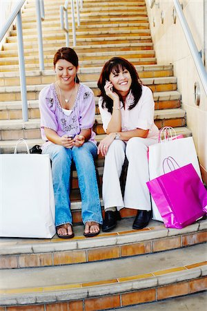 peter griffith - Mother and Daughter Sitting on Steps with Shopping Bags Stock Photo - Rights-Managed, Code: 700-03836213