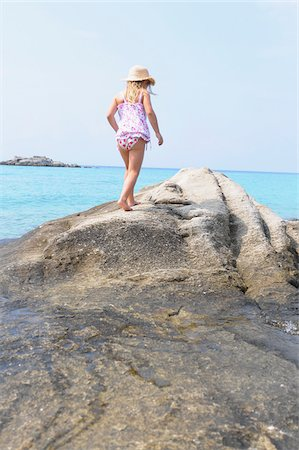 Girl Walking on Boulder at Beach Stock Photo - Rights-Managed, Code: 700-03836228