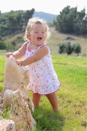 Little Girl Wearing Sundress and Laughing Stock Photo - Rights-Managed, Code: 700-03836236