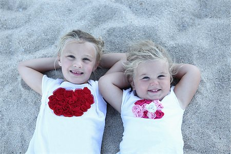Sister Lying on Beach Stock Photo - Rights-Managed, Code: 700-03836258