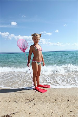 Girl with Net on Beach Stock Photo - Rights-Managed, Code: 700-03836267