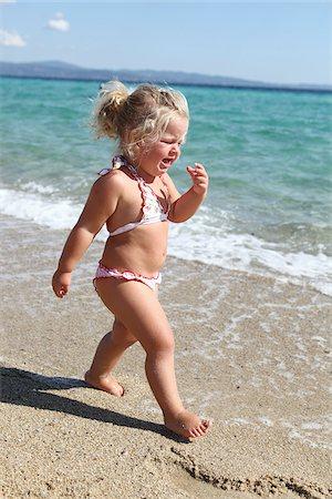 Toddler Wearing Bikini on Beach Stock Photo - Rights-Managed, Code: 700-03836268