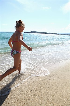 Girl Running on Beach Stock Photo - Rights-Managed, Code: 700-03836263
