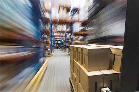 Forklift Moving Boxes in Warehouse Stock Photo - Rights-Managed, Code: 700-03836421