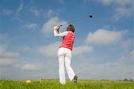 female rear end - Woman Playing Golf Stock Photo - Rights-Managed, Code: 700-03848810