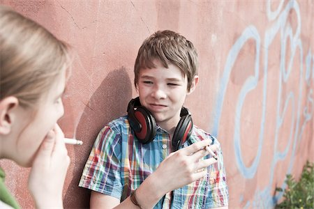 Young Teens Smoking Cigarettes Stock Photo - Rights-Managed, Code: 700-03849060