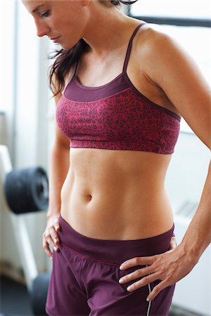 Woman Pausing Between Reps at Gym Stock Photo - Rights-Managed, Code: 700-03849081