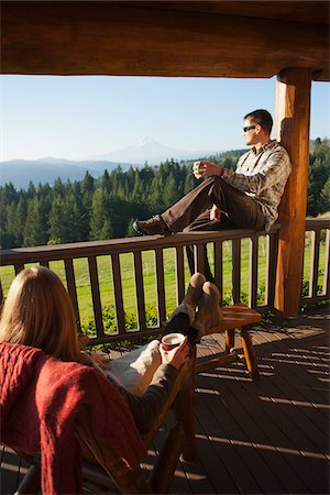 Couple Enjoying Cup of Coffee on Porch Stock Photo - Rights-Managed, Code: 700-03849151