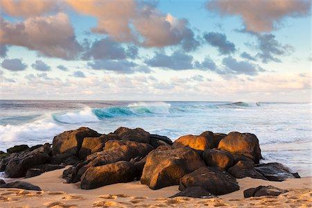 Volcanic Rock on Beach, Waimea Bay, O'ahu, Hawaii Stock Photo - Rights-Managed, Code: 700-03849456