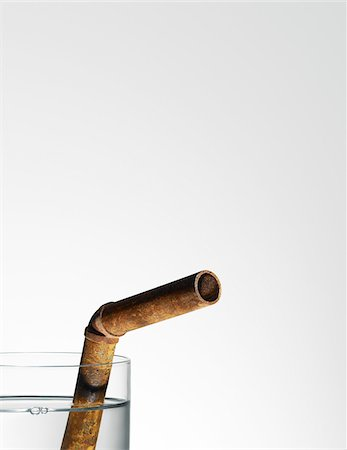 pipe (industry) - Glass of Water with Rusty Pipe for Drinking Straw Stock Photo - Rights-Managed, Code: 700-03849768