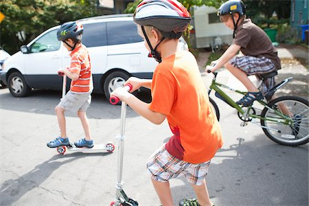 Boys Riding Scooters and Bicycles Stock Photo - Rights-Managed, Code: 700-03865245
