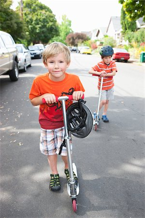 Two Boys Riding Scooters Stock Photo - Rights-Managed, Code: 700-03865246